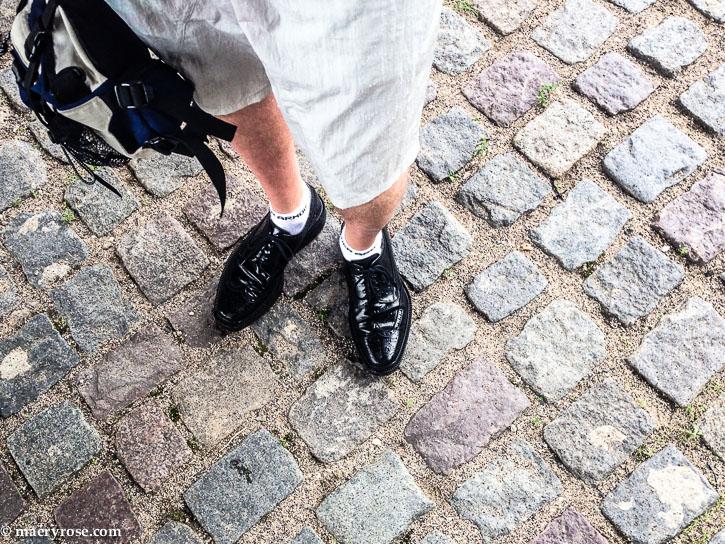 standing on cobblestone street