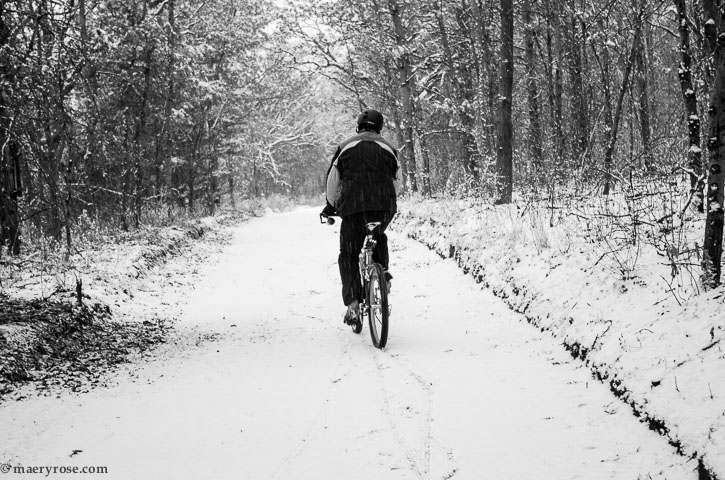 bicycling on snowy path